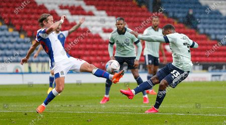 Junior Hoilett of Cardiff has his shot blocked by Lewis Holtby of Blackburn Rovers
