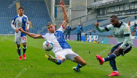 Junior Hoilett of Cardiff tries a shot past Daniel Ayala of Blackburn Rovers
