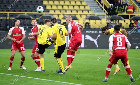 Dortmund's Emre Can (2-R) scores the second goal during the German Bundesliga soccer match between Borussia Dortmund and SC Freiburg in Dortmund, Germany, 03 October 2020.