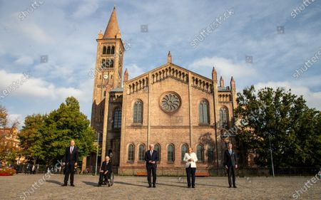 Dietmar Woidke, President of the Federal Council, Wolfgang Schauble, President of German Bundestag, German President Frank-Walter Steinmeier, German Chancellor Angela Merkel, Stephan Harbarth, President of Federal Constitutional Court, in front of a church at Day of German unity - Ecumenical church service in Potsdam