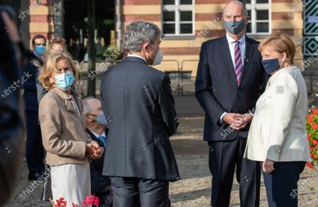 German Chancellor Angela Merkel (r-l), Dietmar Woidke, President of the Federal Council, Stephan Harbarth, President of Federal Constitutional Court, Wolfgang Schauble, President of German Bundestag, with his wife Ingeborg Schaeuble at Day of German unity - Ecumenical church service in Potsdam