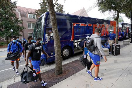 Florida players arrive at Ben Hill Griffen Stadium before an NCAA college football game against South Carolina, in Gainesville, Fla