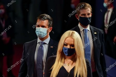 From l-r., Donald Trump Jr., Tiffany Trump and Eric Trump arriving to take their seats for the first presidential debate, at Case Western University and Cleveland Clinic, in Cleveland, Ohio