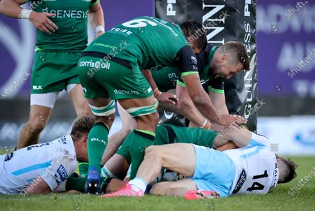 Stock Picture of Connacht vs Glasgow Warriors. Connacht's Quinn Roux scores a try despite Tommy Seymour of Glasgow Warriors