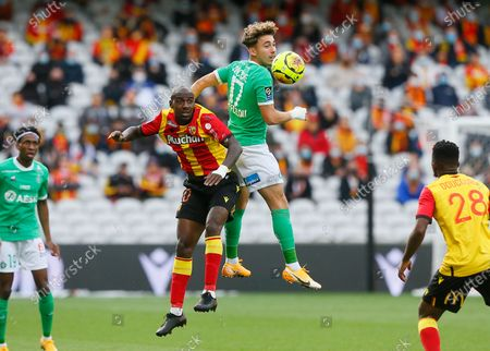 Lens' Gael Kakuta, centre left, and Saint-Etienne's Adil Aouchiche challenge for the ball, during the French League One soccer match between Lens and AS St Etienne, in Lens, northern France