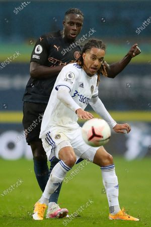 Manchester City's Benjamin Mendy, left, vies for the ball with Leeds United's Helder Costa during the English Premier League soccer match between Leeds United and Manchester City at Elland Road in Leeds, England