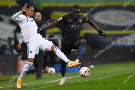 Leeds United's Helder Costa vies for the ball with Manchester City's Benjamin Mendy, right, during the English Premier League soccer match between Leeds United and Manchester City at Elland Road in Leeds, England