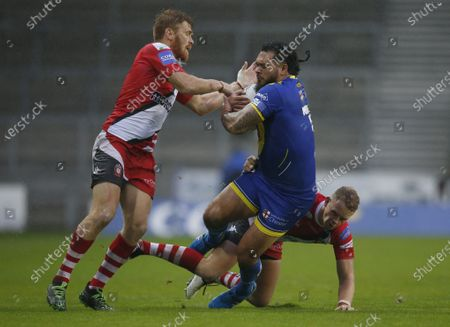 Warrington Wolves' Ben Murdoch-Masila in action with Salford Red Devils' Kris Welham and Kevin Brown
