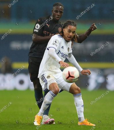 Benjamin Mendy of Manchester City (L) in action against Helder Costa of Leeds (R) during the English Premier League match between Leeds United and Manchester City in Leeds, Britain, 03 October 2020.