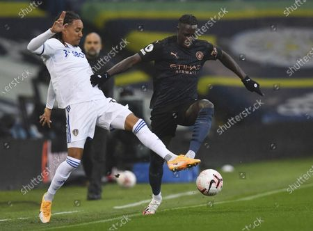 Helder Costa of Leeds (L) in action against Benjamin Mendy of Manchester City (R) during the English Premier League match between Leeds United and Manchester City in Leeds, Britain, 03 October 2020.