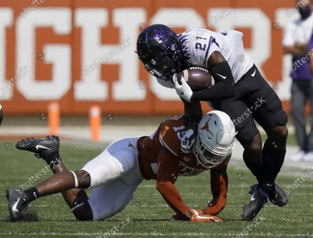 Stock Photo of Running back Daimarqua Foster (21) is hit by Texas defensive back Chris Brown (15) on a run during the first half of an NCAA college football game, in Austin, Texas