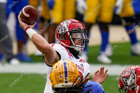 North Carolina State quarterback Devin Leary (13) gets a pass away as Pittsburgh Panthers defensive lineman Patrick Jones II (91) pressures in the first half of an NCAA college football game, in Pittsburgh