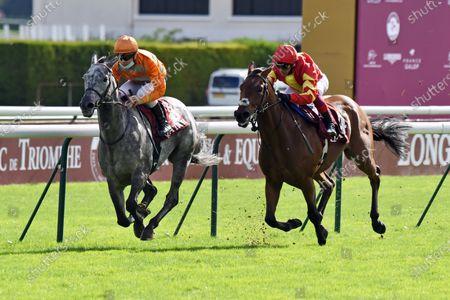 Stock Image of , Longchamp, Skalleti (left) with Maxime Guyon up wins the Qatar Prix Dollar at Paris Longchamp racecourse, FRA.