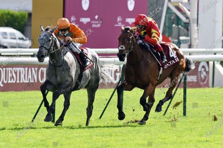 Stock Photo of , Longchamp, Skalleti (left) with Maxime Guyon up wins the Qatar Prix Dollar at Paris Longchamp racecourse, FRA.