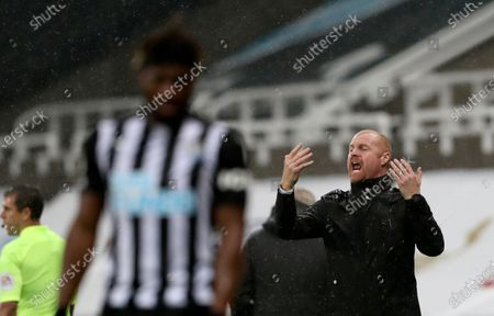 Burnley's manager Sean Dyche, right, reacts during the English Premier League soccer match between Newcastle United and Burnley at St. James' Park in Newcastle, England
