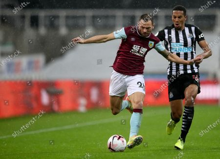 Burnley's Phil Bardsley, left, duels for the ball with Newcastle's Isaac Hayden during the English Premier League soccer match between Newcastle United and Burnley at St. James' Park in Newcastle, England