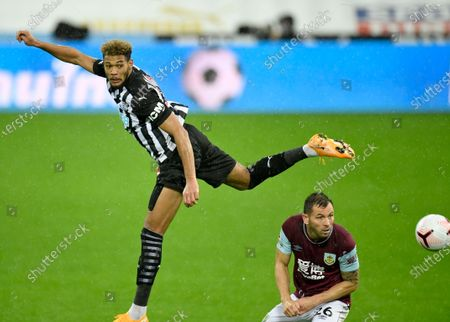 Newcastle's Joelinton, left, duels for the ball with Burnley's Phil Bardsley during the English Premier League soccer match between Newcastle United and Burnley at St. James' Park in Newcastle, England