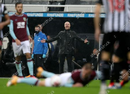 Burnley's manager Sean Dyche, centre, reacts during the English Premier League soccer match between Newcastle United and Burnley at St. James' Park in Newcastle, England