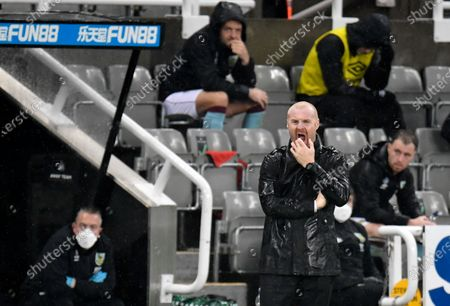 Burnley's manager Sean Dyche reacts during the English Premier League soccer match between Newcastle United and Burnley at St. James' Park in Newcastle, England