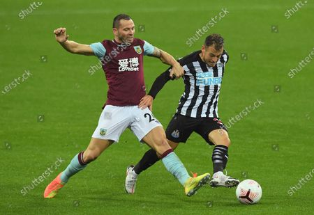 Phil Bardsley of Burnley (L) in action against Ryan Fraser of Newcastle (R) during the English Premier League match between Newcastle United and Burnley in Newcastle, Britain, 03 October 2020.
