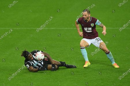 Allan Saint-Maximin of Newcastle (L) in action against Phil Bardsley of Burnley (R) during the English Premier League match between Newcastle United and Burnley in Newcastle, Britain, 03 October 2020.