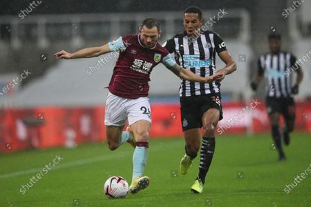 Phil Bardsley of Burnley (L) in action against Isaac Hayden of Newcastle (R) during the English Premier League match between Newcastle United and Burnley in Newcastle, Britain, 03 October 2020.