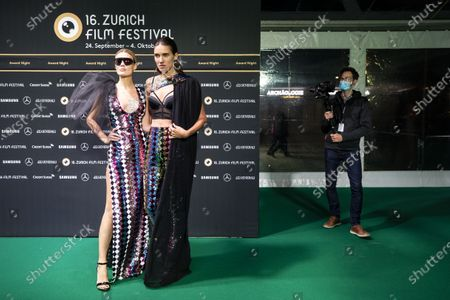 Stock Image of Dominique Rinderknecht (L) and Tamy Glauser (R) pose on the Green Carpet during the Award Night ceremony at the 16th Zurich Film Festival (ZFF) in Zurich, Switzerland, 03 October 2020. The festival runs from 24 September to 04 October 2020.
