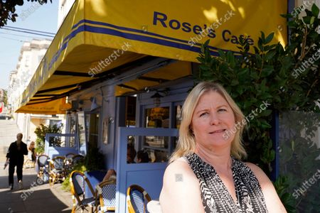 """Laurie Thomas poses outside of her Rose's Cafe restaurant, in San Francisco. California's landmark ballot measure that keeps a lid on property taxes by tying them to the most recent purchase price is facing one of its biggest challenges in its 42-year history. Proposition 15 on the Nov. 3 ballot would reassess commercial and industrial properties every three years. Thomas, who owns two restaurants in San Francisco, said Proposition 15 would be """"one more nail in the coffin"""" of her industry"""