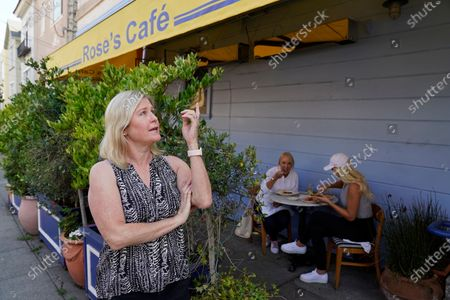 """Laurie Thomas talks about the building where her Rose's Cafe restaurant is located, in San Francisco. Proposition 15 on the Nov. 3 ballot would reassess commercial and industrial properties for taxes every three years. Thomas, who owns two restaurants in San Francisco, said Proposition 15 would be """"one more nail in the coffin"""" of her industry. She laid off 65 employees when the coronavirus struck in March, reopening about four months later with 45 for outdoor seating only"""