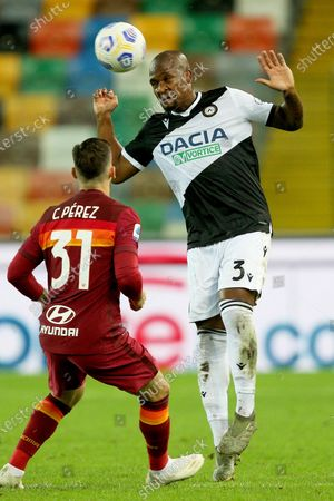 Udinese's Samir (R) and Roma's Carlos Perez in action during the Italian Serie A soccer match Udinese Calcio vs AS Roma at the Friuli - Dacia Arena stadium in Udine, Italy, 03 October 2020.
