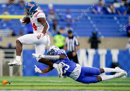 Mississippi running back Snoop Conner (24) is tackled by Kentucky defensive back Tyrell Ajian (23) during the first half of an NCAA college football game, in Lexington, Ky