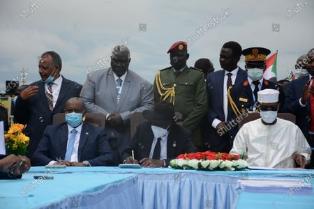 Stock Image of (L-R, sitting) Chairman of the Sudanese Sovereign Council Abdel Fattah al-Burhan, President of South Sudan President Salva Kiir and President of Chad Idriss Deby attend the signing ceremony of the peace deal between the Sudanese government and rebel groups, in Juba, South Sudan, 03 October 2020. The Sudanese transitional government and rebel groups on 03 October signed a peace agreement that aim to put an end armed conflicts across the country.