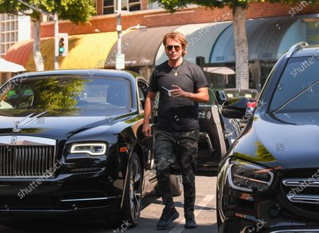 Jonathan Cheban is seen getting out of his Rolls Royce and eating Pinkberry