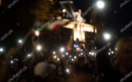 People light up with their cell phones during an anti-government protest held in front of the Parliament building in Sofia, Bulgaria, 03 October 2020. Hundreds of demonstrators once again gathered in the capital's downtown area to demand the resignation of Prime Minister Boyko Borissov and his government.