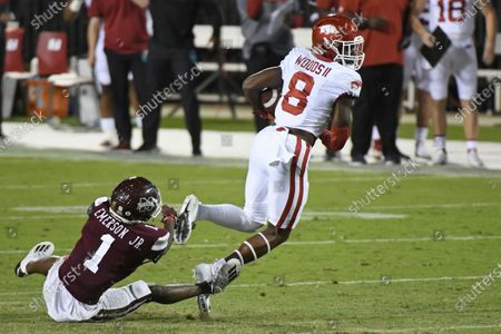 Arkansas wide receiver Mike Woods (8) breaks away from Mississippi State cornerback Martin Emerson (1) during the first half of an NCAA college football game in Starkville, Miss