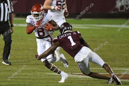 Mississippi State cornerback Martin Emerson (1) tackles Arkansas wide receiver Mike Woods (8) during the second half of an NCAA college football game in Starkville, Miss., . Arkansas won 21-14