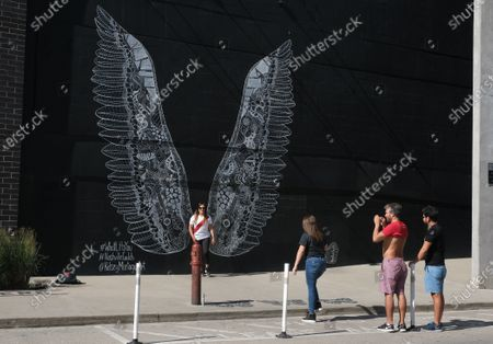 Stock Image of What Lifts You Wings mural by artist Kelsey Montague in Nashville,TN.