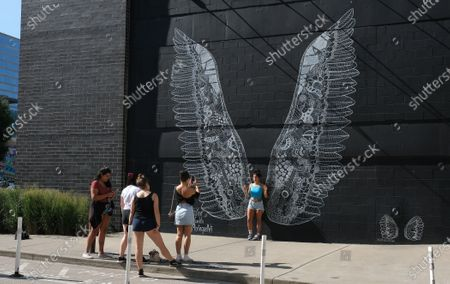 Stock Picture of What Lifts You Wings mural by artist Kelsey Montague in Nashville,TN.