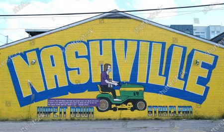 George Jones on the riding lawnmower comes from the Mike Judge series Tales From the Tour by artist Shawn Catz, in Nashville,TN.