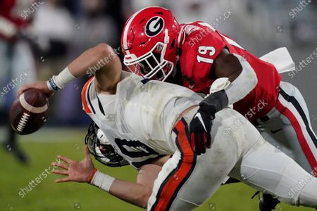 Georgia linebacker Adam Anderson tackles Auburn quarterback Bo Nix (10) during the second half of an NCAA college football game, in Athens, Ga