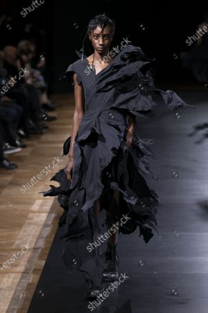 Model on the catwalk wearing an outfit from the women s ready to wear collections, spring summer 2021, original creation, during the Womenswear Fashion Week in Paris, from the house of Yohji Yamamoto