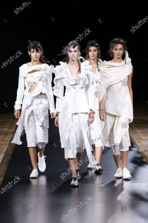 Models on the catwalk wearing an outfit from the women s ready to wear collections, spring summer 2021, original creation, during the Womenswear Fashion Week in Paris, from the house of Yohji Yamamoto