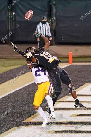 Cornerback Derek Stingley Jr. (24) breaks up a pass intended for Vanderbilt wide receiver Chris Pierce (19) in the first half of an NCAA college football game, in Nashville, Tenn
