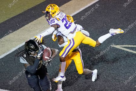 Vanderbilt wide receiver Chris Pierce, lower left, can't hang onto a pass in the end zone as he is defended by LSU cornerback Cordale Flott (25) in the second half of an NCAA college football game, in Nashville, Tenn. LSU won 41-7