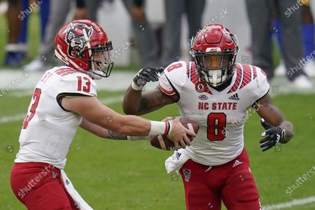North Carolina State quarterback Devin Leary (13) hands off to running back Ricky Person Jr. (8) during an NCAA college football game, in Pittsburgh