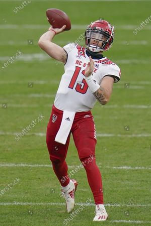 Stock Picture of North Carolina State quarterback Devin Leary (13) plays against Pittsburgh Panthers during an NCAA college football game, in Pittsburgh