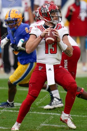 Stock Image of North Carolina State quarterback Devin Leary (13) plays against Pittsburgh Panthers during an NCAA college football game, in Pittsburgh