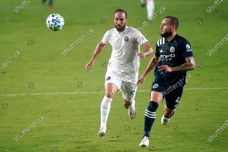 Inter Miami forward Gonzalo Higuain (9) and New York City FC defender Maxime Chanot (4) chase down the ball during the first half of an MLS soccer match, in Fort Lauderdale, Fla