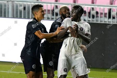 Inter Miami midfielder Blaise Matuidi, right, and New York City FC defender Sebastien Ibeagha, center, get involved in an altercation during the second half of an MLS soccer match, in Fort Lauderdale, Fla
