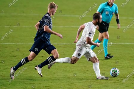 Inter Miami forward Gonzalo Higuain, front right, runs with the ball as New York City FC midfielder Keaton Parks defends during the first half of an MLS soccer match, in Fort Lauderdale, Fla